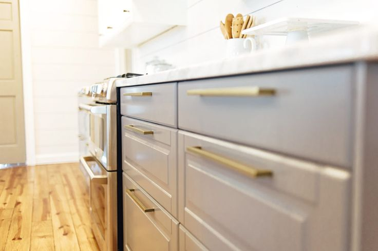 Ikea Bodbyn gray cabinets with brass hardware