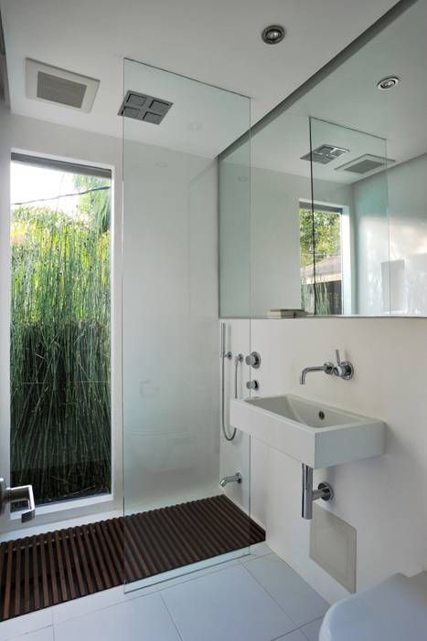 5x5 bath remodel by XP & Architecture. Love the clear glass shower panel - makes the small bathroom look larger