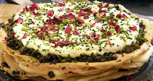 Pistachio rose cake cakecumindessertphyllopistachioroséspice trip  Prep: 20 mins  Cook: 20 mins Ingredients      12 filo pastry sheets, cut into 30cm (12in) discs (use base of the cake tin as a guide)     75g (2 ½ oz) butter, melted     300g (11oz) pistachios, roughly chopped     1 ½ tbsp black cumin (Nigella or Kalonji) seeds     6 tbsp honey     6 tbsp rose water     500ml (18fl oz) double cream     Dried or fresh rose petals, to decorate  Directions      Preheat the ove...