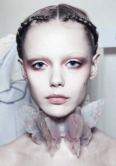 Frida Gustavsson wearing a butterfly neckpiece backstage at Valentino Haute Couture Spring/Summer 2011 - part 2