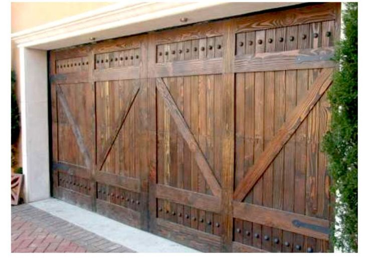 Alpine rustic wood garage door with v grooved panel for Rustic wood garage doors