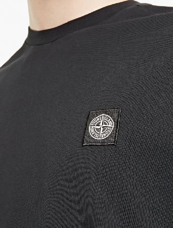 Stone Island Black Cotton Logo T-Shirt The Stone Island Cotton Logo T-Shirt for SS17, seen here in black. - - - Crafted from premium cotton and cut to offer a relaxed fit, this t-shirt from Stone Island is finished with the brand™s distinc http://www.MightGet.com/march-2017-2/stone-island-black-cotton-logo-t-shirt.asp