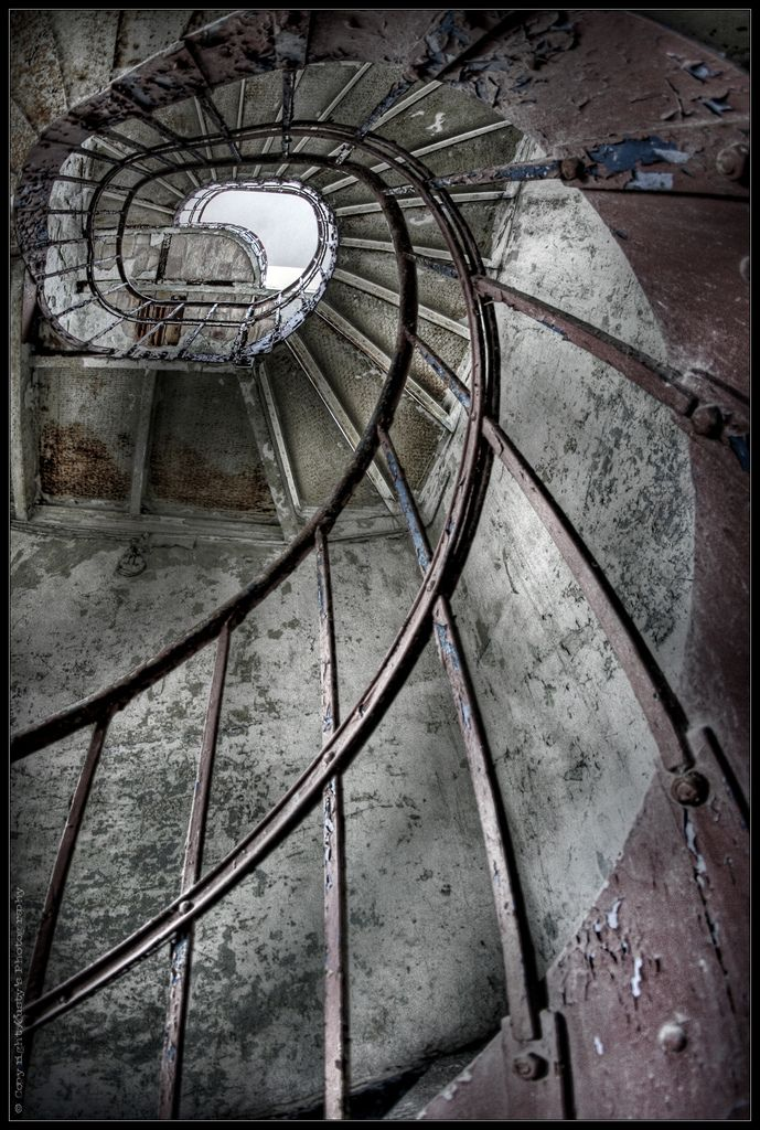 Abandoned Building Spiral Staircase. Pealing Paint, Decay And Rust.