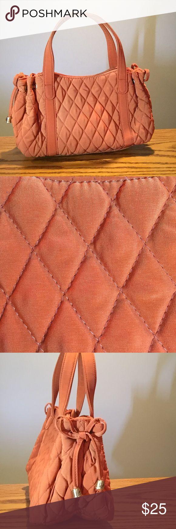 "Vera Bradley Orange Quilted wrist bag Like new Vera Bradley Orange Quilted wrist bag has snap closure and one inside pocket.  10x4x6"" Vera Bradley Bags"