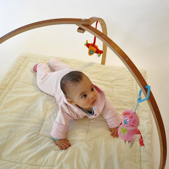 I think this would be totally worth the price, I found this really awesome Etsy listing at https://www.etsy.com/listing/178391927/mahogany-veneer-coated-baby-gym-wooden