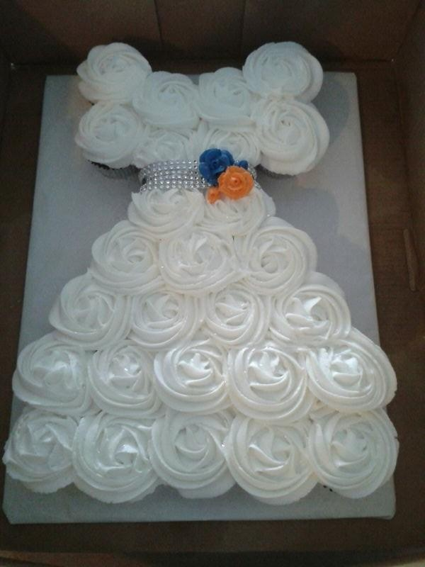 cupcake cake in the shape of a wedding dress for a bridal shower