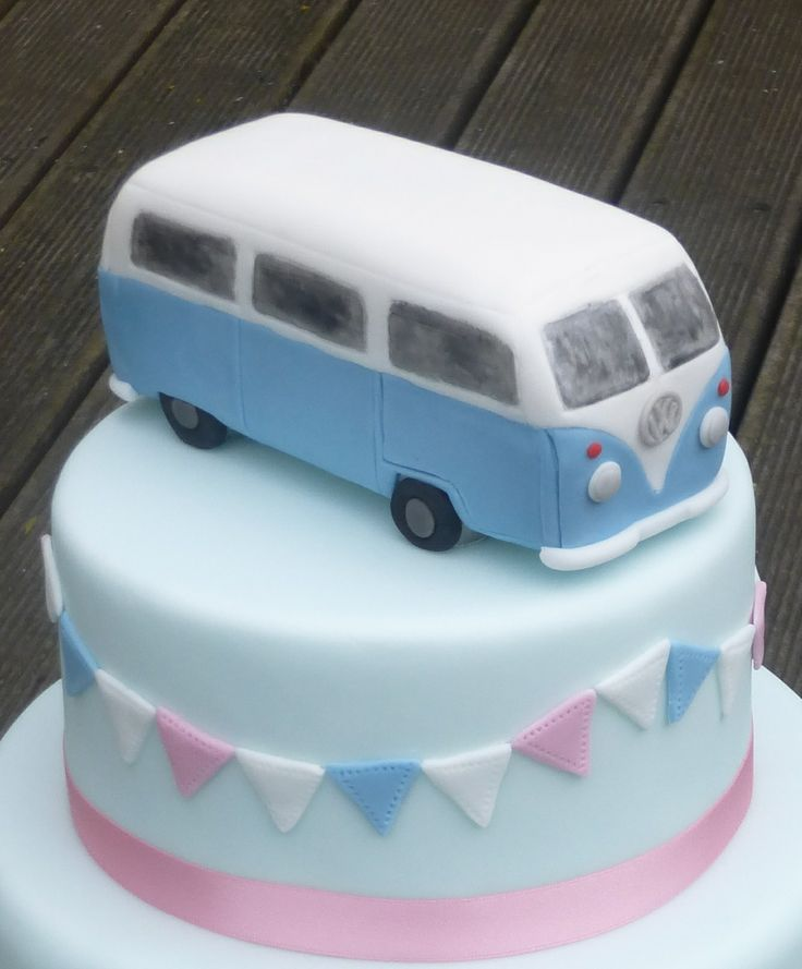 A close up of VW camper Van wedding cake topper. It's made from rice crispy treats and cover and ...