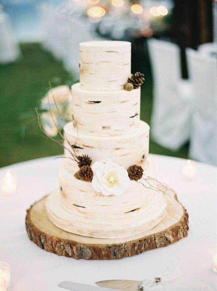 Rustic Four-Tier Wedding Cake With Sugar Flowers and Pinecones