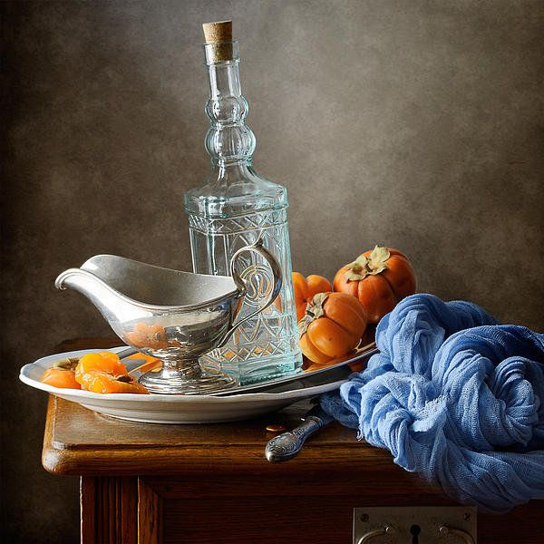 http://nikolay-panov.artistwebsites.com/products/persimmons-and-blue-drapery-nikolay-panov-art-print.html • Still life with persimmons, blue bottle and light blue drapery on wooden table in kitchen.