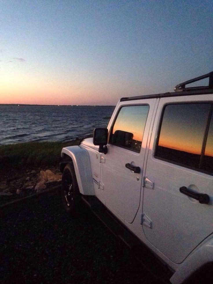 White jeep wrangler beach