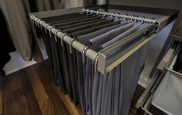 New Reveal sliding pant rack is an efficient way to store pants in the closet. Click to see how it works now | Organized Living