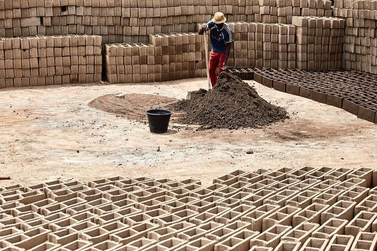 Un monton de maçons  Bangoua's village  Cameroon.  Under the burning sun a man is working on his activity he builds bricks with his own hands for all the day every days. #construction #built #sun #hot #bricks #work #africa #pattern #repetition #reportagespotlight #photojournalisticphotography #reportage #photography #photographer #photo #journalism #flick #spicollective #photocontest #man #sand