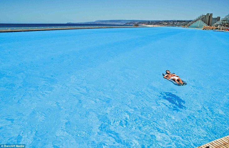 Lost at sea: A bather floats on the amazingly clear waters of the vast Crystal Lagoon, at the San Alfonso del Mar resort, Chile  ( worlds largest swimming pool): The Mars, Largest Swim, World Largest, Resorts, Swim Pools, Vacations Spots, Meter Long, 80 Acr, Outdoor Pools
