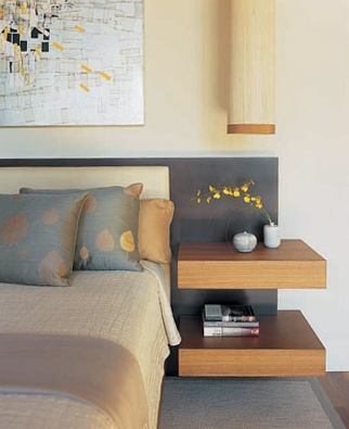 Floating shelves as bedside table and a room co-ordinating sconce :)