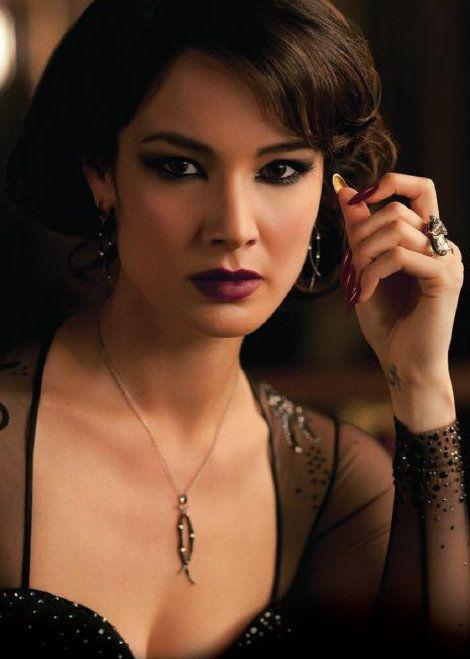 Love her eye makeup, hair and dress..hot Bond's girl