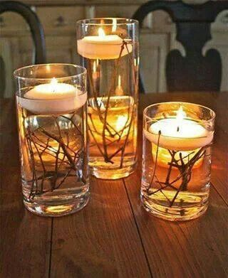 Easy centerpieces. Water, branches & candles. (You could color the water too!)