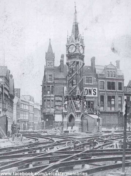 https://flic.kr/p/cZcUey | Clock Tower | A 1903 view of the Clock Tower in the centre of leicester, surrounded by new tram tracks being laid. The complex nature of the trackwork, supplied by Hadfields of Sheffield, is clearly evident. The narrow street ahead is Churchgate and one familiar name, Freeman Hardy and Willis, synonymous with boots and shoes, occupies the imposing building behind the Clock Tower..— at (National Tramway Museum).