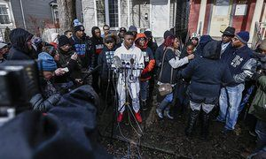 Activists, family and neighbors gather to speak to the media outside the location where Chicago police were called to a domestic disturbance that resulted in the shooting deaths of Bettie Jones and Quintonio LeGrier.