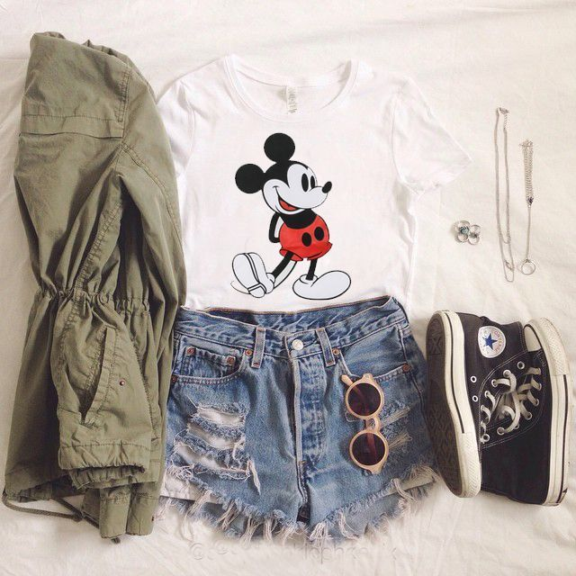 | White Graphic Tee | Army Green Jacket | High Waisted Denim Distressed Shorts | Black High Top Converse |