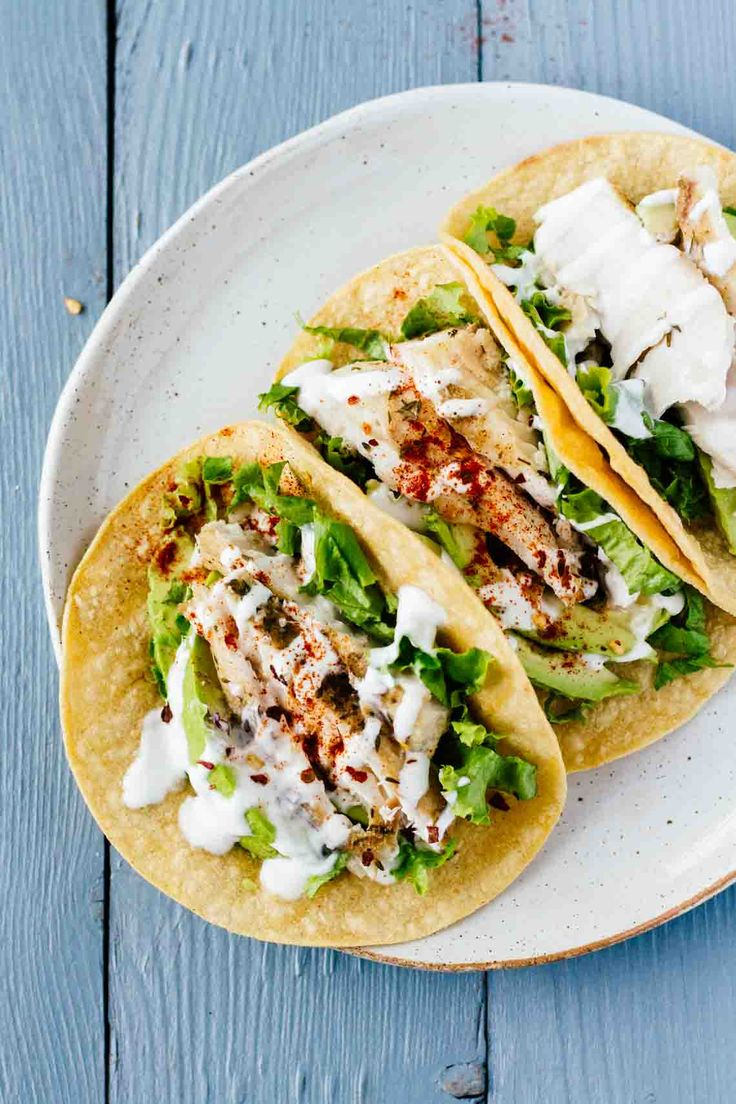 Creamy, savory, and healthy Baked Mahi-Mahi Tacos! They're also gluten-free, loaded with protein, and SO easy to make. Try out the recipe on Jar Of Lemons!