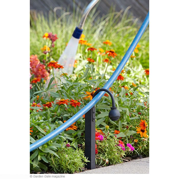 Hose guide how-to | What a fabulous idea!... and an inexpensive yet attractive accessory to the garden.*