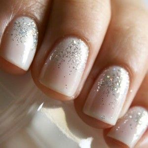Easy bridal nail art: Studio White Shellac with a silver glitter fade from the cuticle.