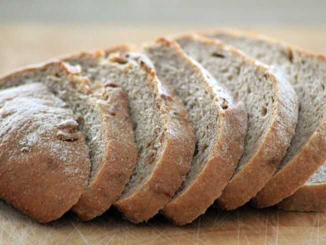 Made with milk, sugar, salt, oil, yeast, water, flour, rye flour, caraway seeds, onion | CDKitchen.com