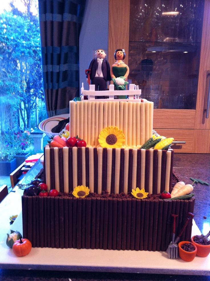 Allotment themed wedding cake, chocolate cigarillos, vegetables, sunflowers, gardening equipment, alternative bride  groom.