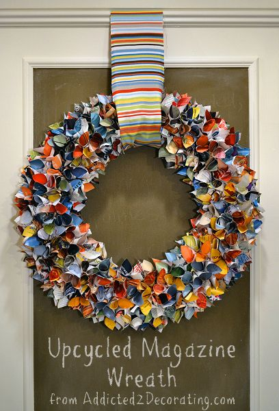 A vibrant everyday wreath made of upcycled magazine pages from addicted2decorating.com