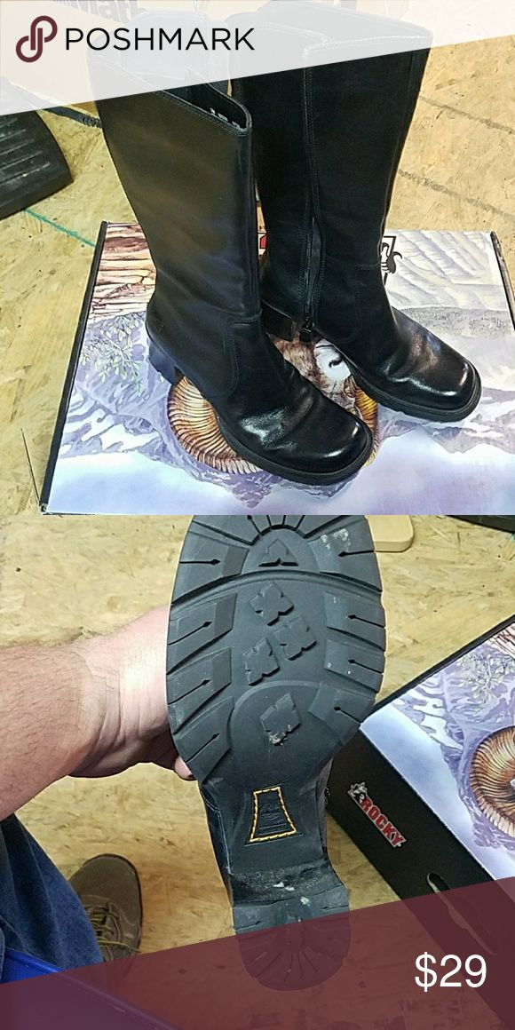 Timberland Boots  size 7M Ladies Timberland leather boots size 7M black , zip up closure, lug sole 2 inch heel, 13 inch high from top of heel.   Measure around calf is 14.5 inches with elastic at the back.   come in non original box.  Only worn a couple of times. Timberland Shoes Heeled Boots