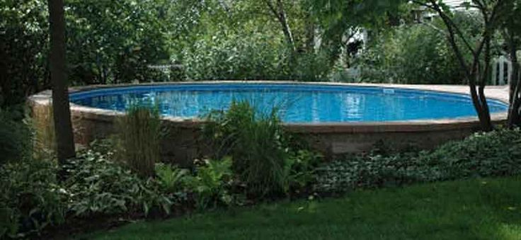 31 best images about pool deck on a slope on pinterest for Above ground pool siding ideas