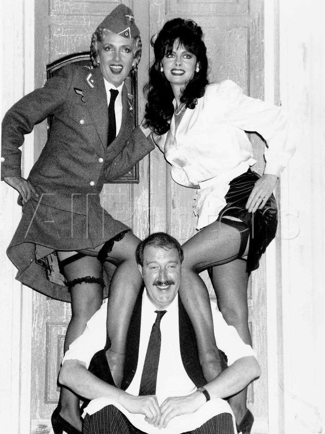 "Vicki Michelle Actress with Co-Stars in the 80s British Television Series ""Allo Allo"" Gordon Kaye and Kim Hartman."
