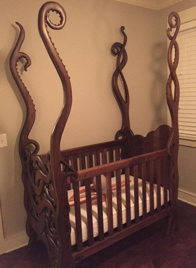 This is the tentacle crib carved out of walnut by Atlanta based woodworker Garrick Andrus for some friends, who commissioned the piece.