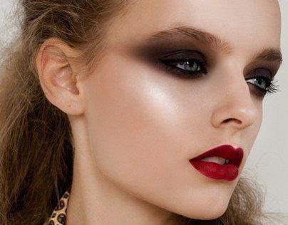 Dark black smokey eye and red lip. great highlighting
