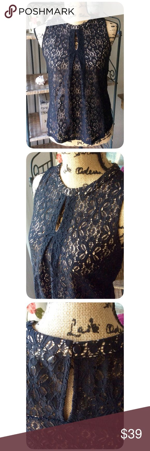 Black and Nude Crochet Style Top Love this top! Black and Nude Crochet Style Top. Shell is 67% Cotton, 33% Nylon. Lining is 100% polyester. Made in Vietnam. New without tags. Different sizes in stock! Monteau Tops