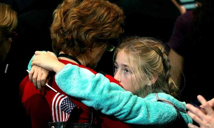 A girl hugs a woman as she watches voting results last night at the Jacob K. Javits Convention Center.