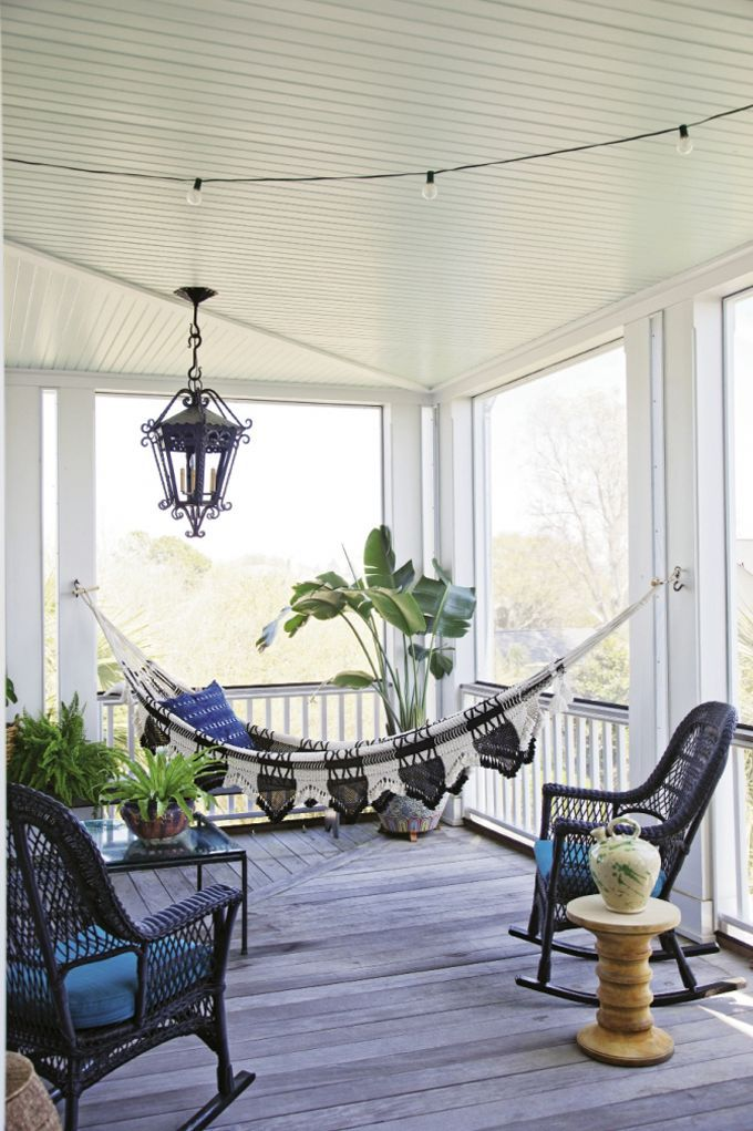 Bohemian dream porch with rocking chairs, hanging lantern and hammock.