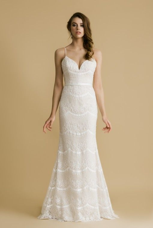 OCC114T Erica The allover lace on this dress is embroidered in scallop details that are heavily beaded and embellished.