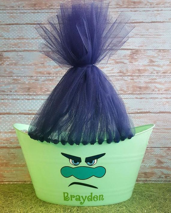 Trolls! This troll basket for a boy is one of our hottest items this year.  This oval tub makes a great Easter basket and can be used for a toy storage basket or snack bucket after Easter. Also perfect for themed birthday parties as well.  Easter is coming soon so order early. We do ship by USPS Priority mail so you still have time! The measurements of this basket 12 1/2 long, 9 1/2 wide, and 6 deep.