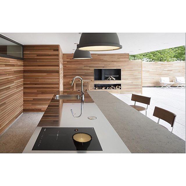 #outdoorkitchen #outdoorliving #fireplace #outdoorroom #concretebench #insideout #alfresco #outdoor #kitchen #landscape #timbercladding #interiordesign #landscapedesign #pool #customhomes by customhomes