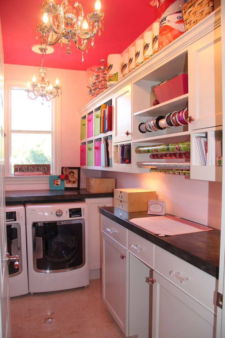 This is my pantry/laundry/gift wrapping room that is a new space we allocated during the space design.  It is right across from the butler's pantry.  The ceiling is fuschia and walls are cotton candy pink because I wanted to tie in a hot pink and silver damask wallpaper in the adjacent dining room.  I am the only woman in my house of three sons and husband, gotta have pink!
