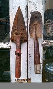 Rusty garden tools as door handles.  We did something like this on our new gate into Bert's veggie garden.  Too cute!
