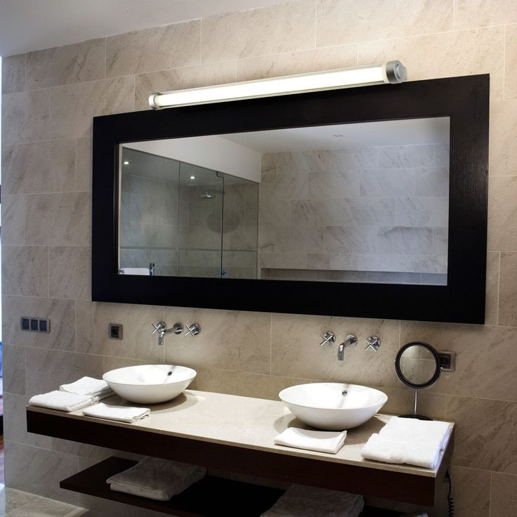 Love the connection between the rounded sinks and the vanity light, as well as the contrast between round and square! Featured Product: Class Vanity Light