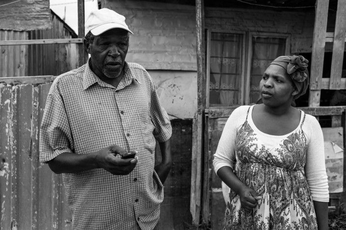 21 Icons crew member Bulelwa Zungula  and community member William Daniso on   location for Zackie Achmat's 21 Icons portrait   shoot. Khayelitsha, Cape Town.  Behind the Scenes Photographer: Gary Van   Wyk  From left, William Daniso, Bulelwa Zungula  Date 20.02.2012