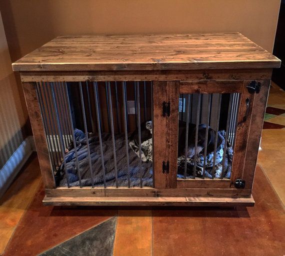 Beautifully crafted home for your pet! This kennel/table serves as a dual functioning piece of furniture. This eliminates the need of moving a large crate around to save space! This unit is wrapped in steel round bar, which not only will last, but gives it a clean look. Finished with a beautiful stain color of your choosing & tough finish, this kennel will last for years to come and be the perfect conversation starter! Kennel pictured measures 48L x 30W x 36H  Can be custom made to fit any…
