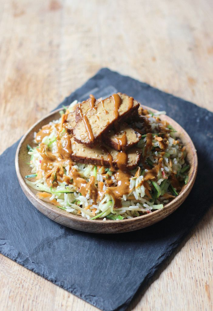 Vegan Asian Brown Rice Salad with a creamy, spicy peanut sauce. Topped with smoked tofu to finish! GF