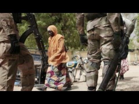 (3238) Boko Haram abducts more than 100 girls from Nigerian school - YouTube