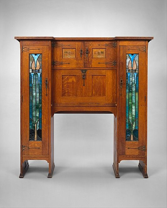 Desk by the Stickley Brothers; dated 1904.  Quarter-sawn oak, oak veneer, cedar, mahogany, brass, copper, pewter, leaded glass.  60 x 58 x 14.  See next pin for interior detail. www.metmuseum.org