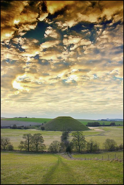 ~Silbury Hill in Avebury, Wiltshire is the largest man-made mound in Europe, it compares in height and volume to the roughly contemporary Egyptian pyramids. Probably completed in around 2400 BC, it apparently contains no burial. Though mysteriously  important in itself, its purpose and significance remain unknown. There is no access to the hill itself. It is part of the Avebury World Heritage Site.   Stonehenge is 16 miles away~