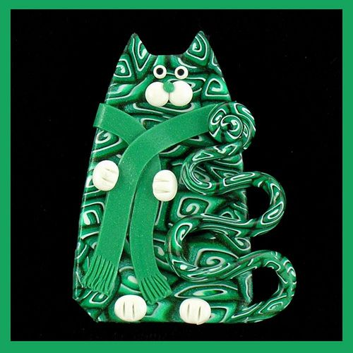 Green Kitty Cat Wearing a Scaft Pin by artsandcats, via Flickr
